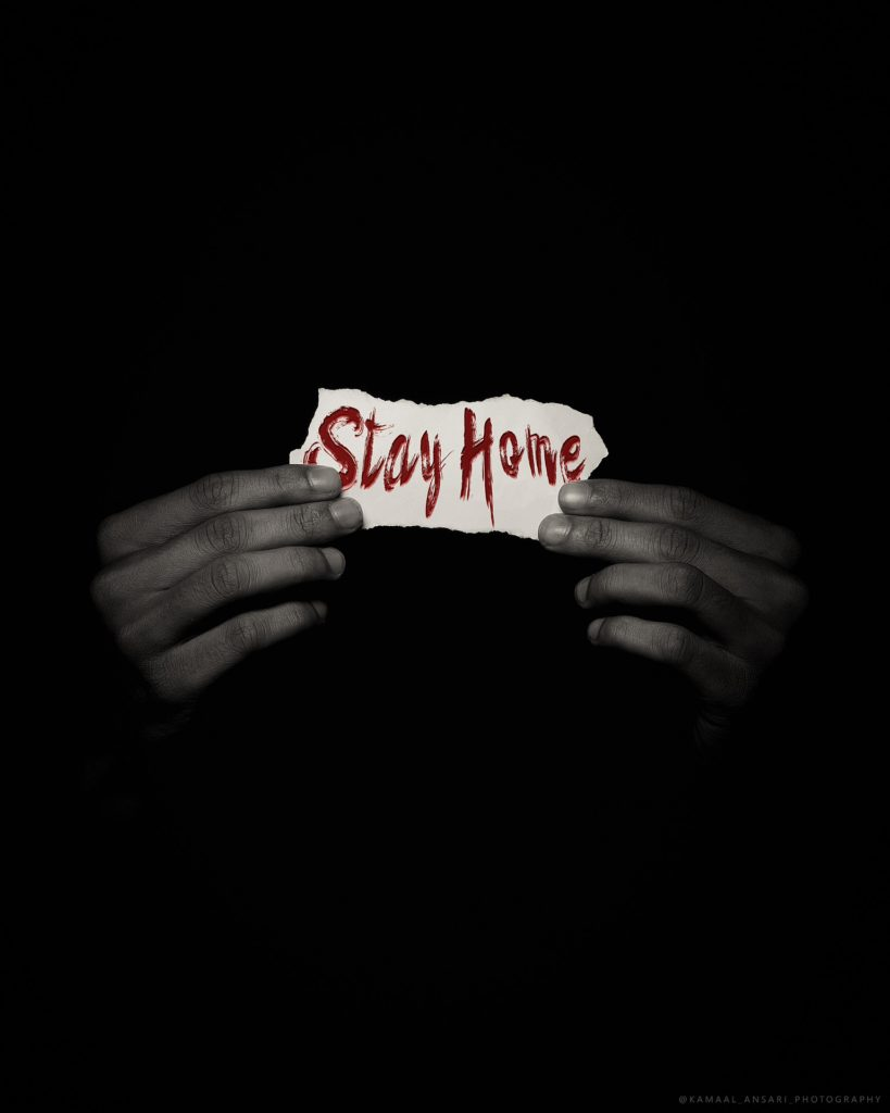 Hands holding 'stay home' sign. Image by Kamaal Ansari from Pixabay